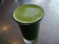 A glass of fresh wheatgrass juice